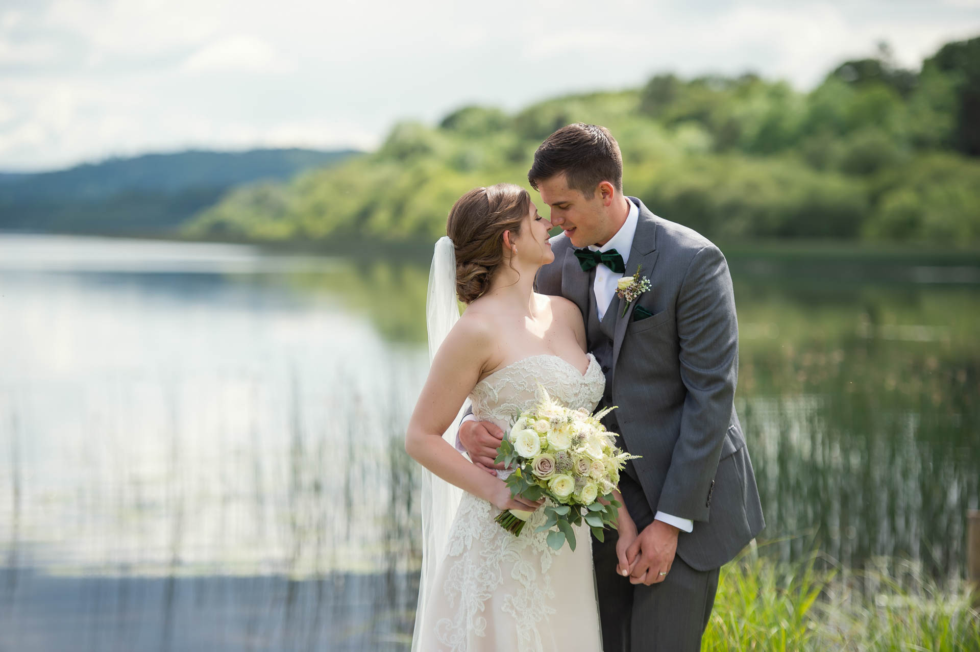 Photo of Lindsey and Jarred on their wedding day pictured at the Loughside at Belle Isle Castle and Estate