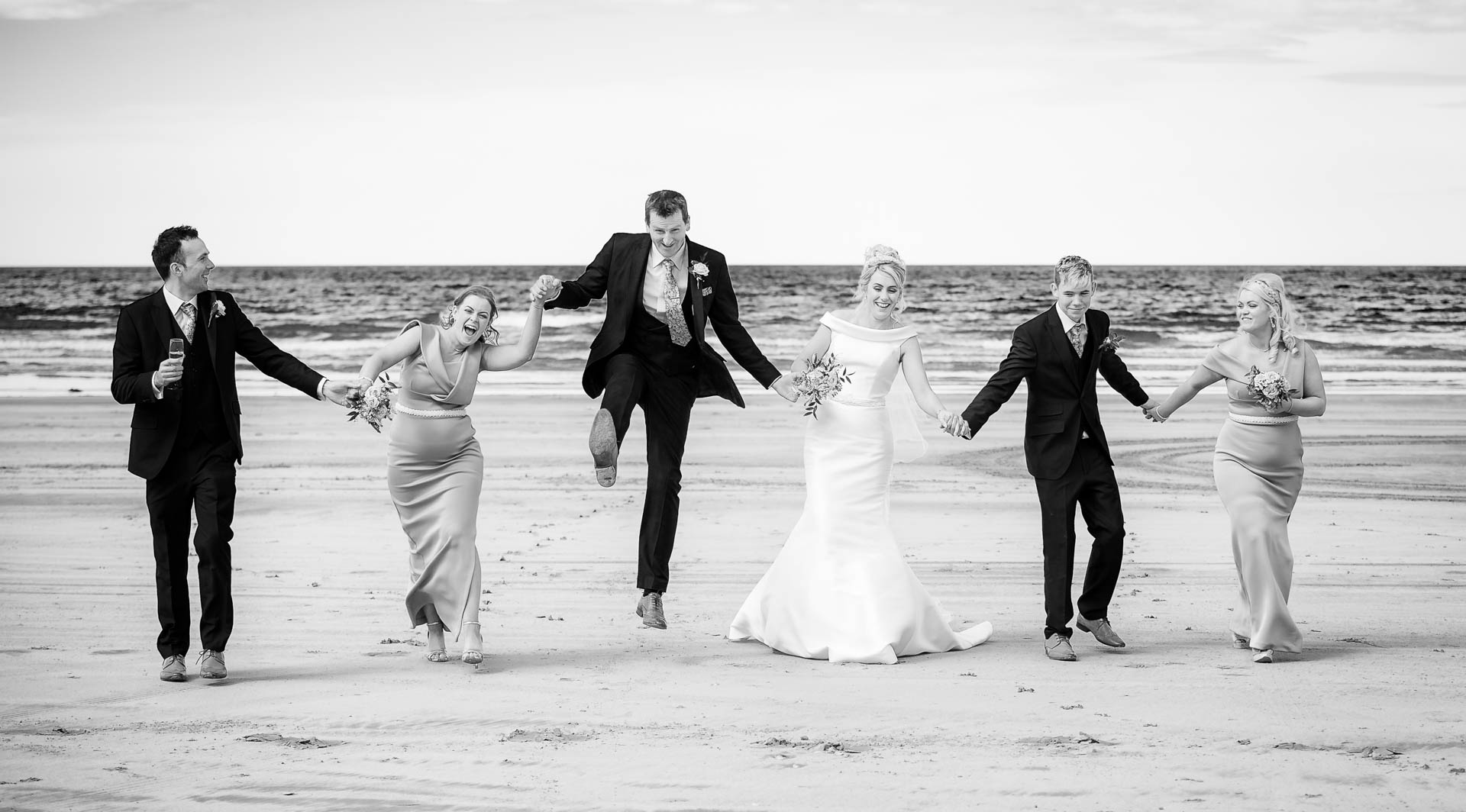 Picture of Noeleen and Cahal at Benone Beach on their wedding day, captured by Fermanagh, Tyrone and Northern Ireland Wedding Photographer, Trevor Lucy Photography
