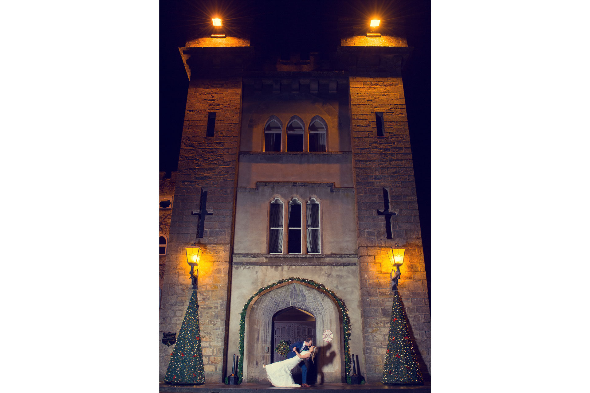 Photo of Alison and James on their wedding day, captured at the front of Cabra Castle Hotel, Kingscourt, Co. Cavan, Ireland, at Christmas time.