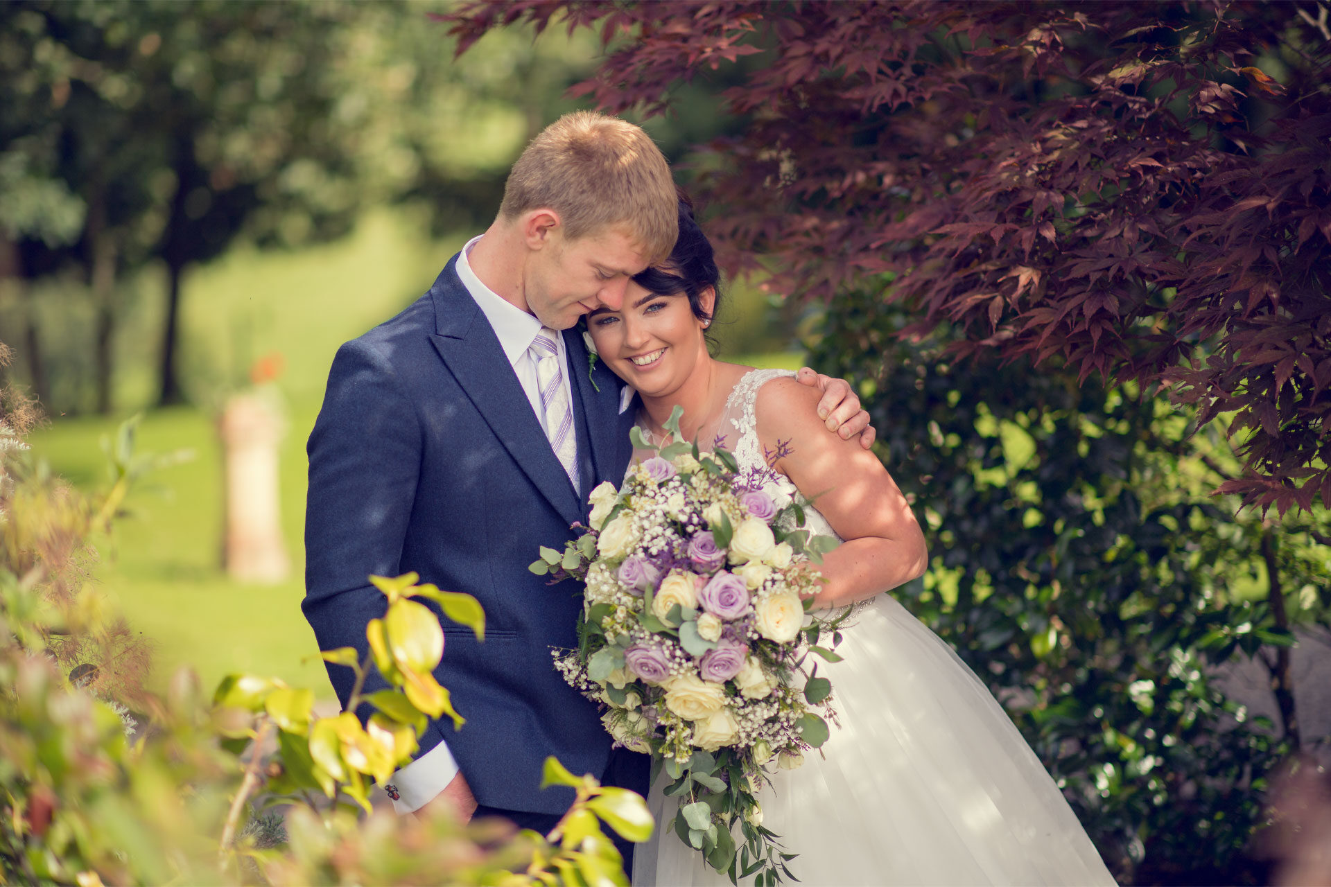Photo of Laura and Samuel on their wedding day, captured in the grounds of Corick House Hotel and Spa, Clogher, Co. Tyrone, Northern Ireland.