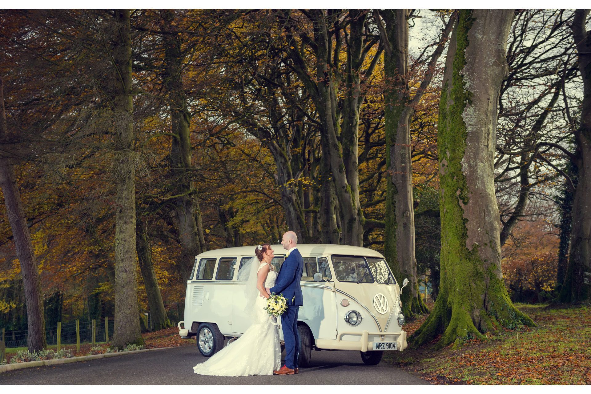 Photo of Chrissy and Kenny on their wedding day, captured with their wedding car along the tree lined driveway to Corick House Hotel, Clogher, Co. Tyrone, Northern Ireland.
