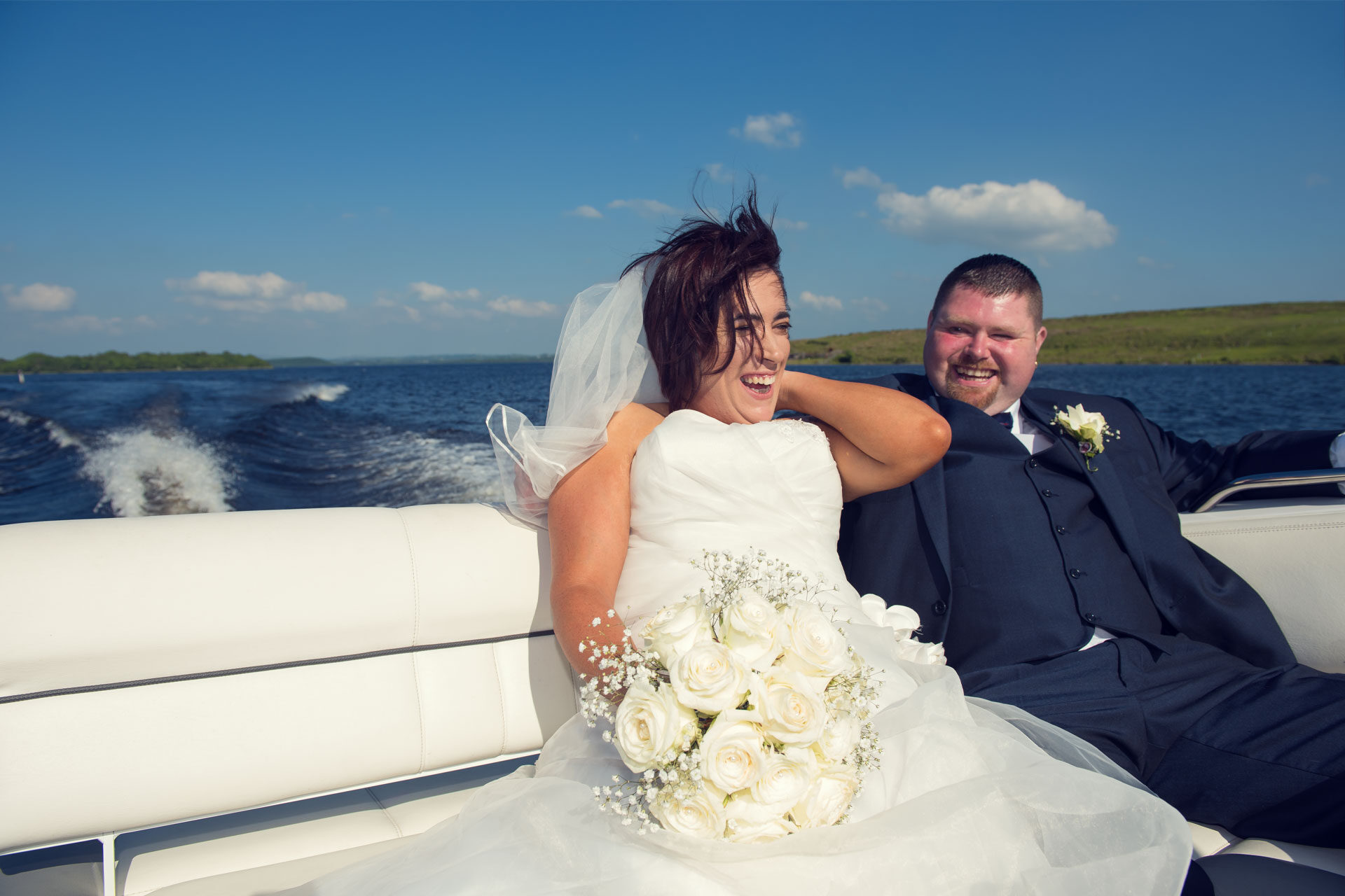 Photo of Leanne and Kevin on their wedding day, on board the Lusty Beg Hotel speed boat at Lusty Beg island, Co. Fermanagh, Northern Ireland.