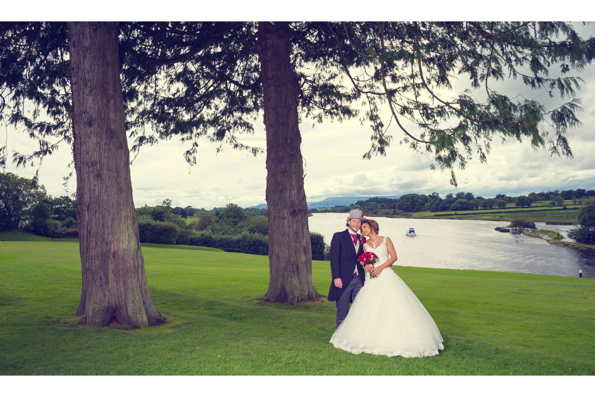 Photo of Deniz and Stevie on their wedding day, captured at Killyhevlin Hotel, Enniskillen, Co. Fermanagh, Northern Ireland.