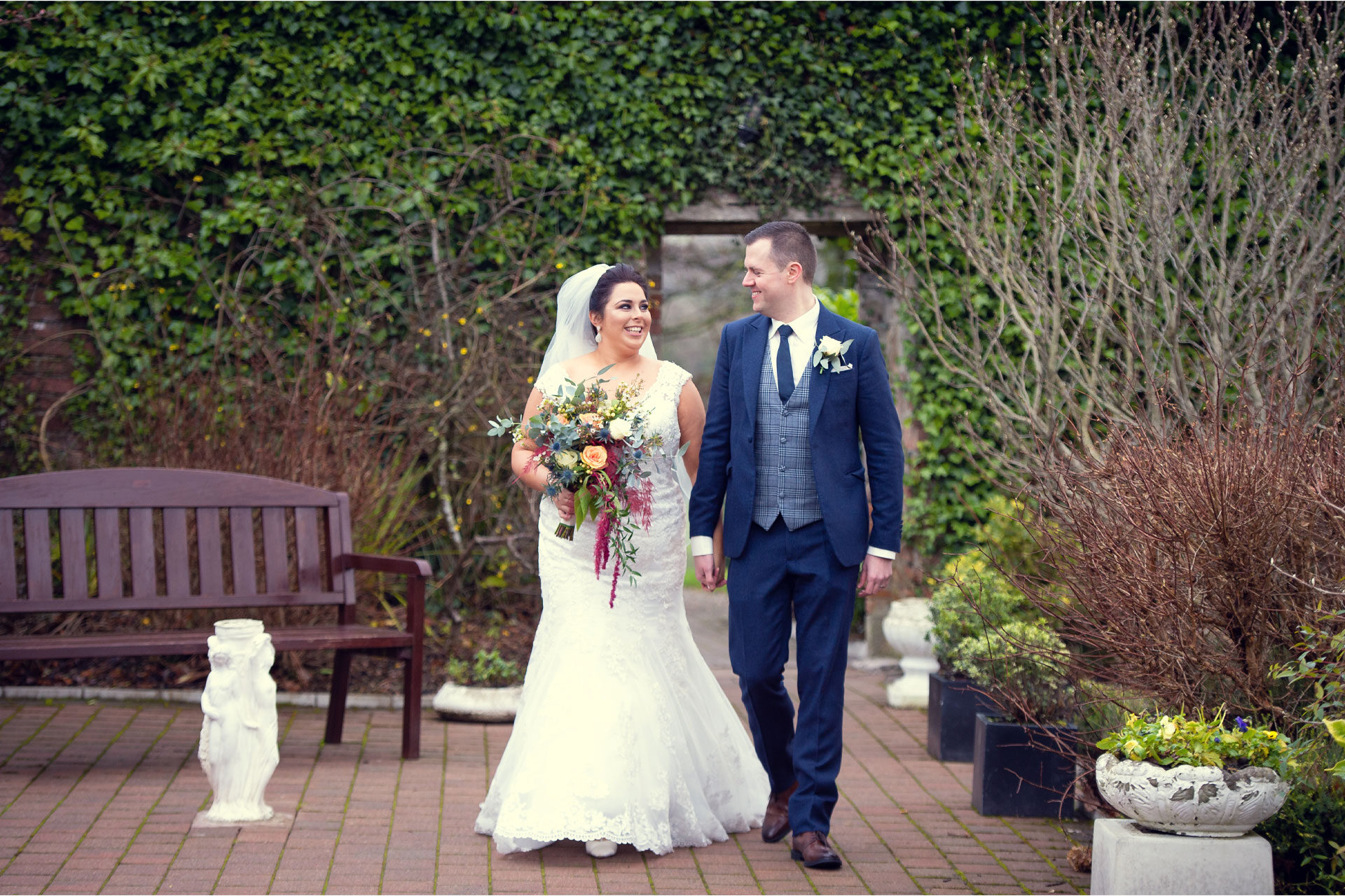 Photo of Clare and Gary on their wedding day, captured in the grounds of