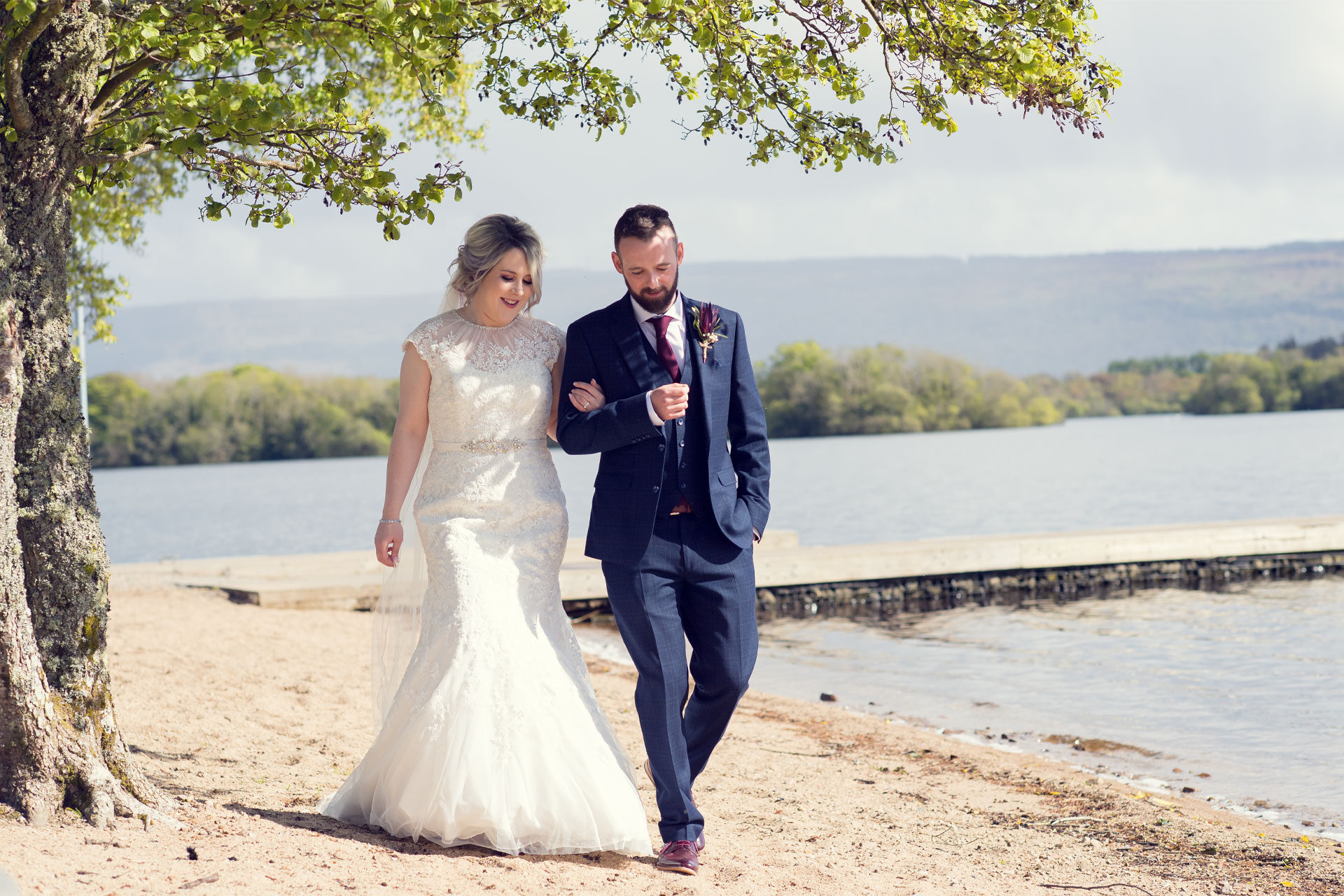 Photo of Carla and Gareth on their wedding day, captured in the beach area of Rossharbour Resort, Co. Fermanagh, Northern Ireland.