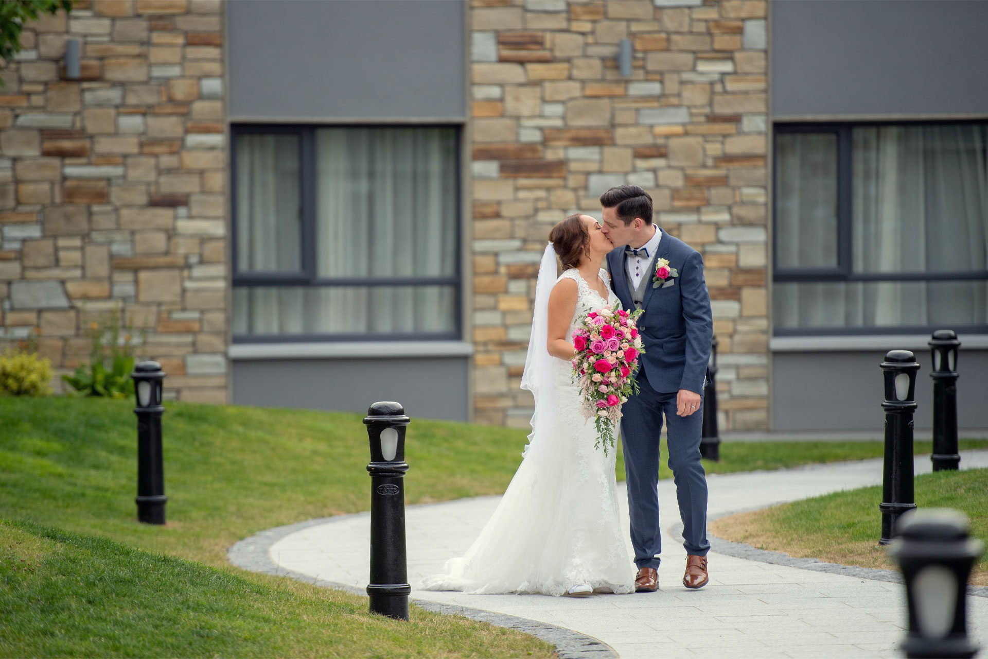 Photo of Tamryn and Paul on their wedding day, captured in the courtyard area of Hotel Kilmore, Co. Cavan, Ireland.